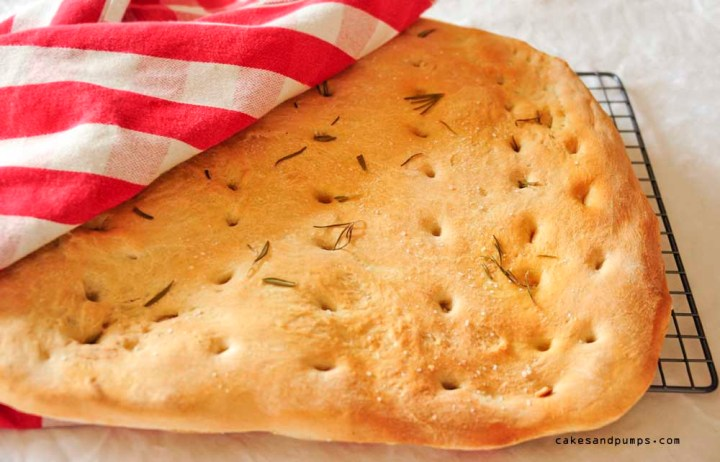 Homemade focaccia bread with rosemary, olive oil and sea salt