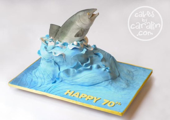 Jumping fish cake. 3D sculpted fish jumping out of a wave.