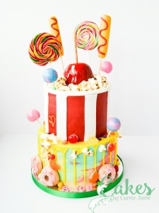Fair food 2 tier birthday cake with corndogs, lollipops, donuts and popcorn