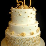 fiftieth wedding anniversary cake, gold anniversary cakes portland, gold pearl cake, gold scrollwork fondant cake round