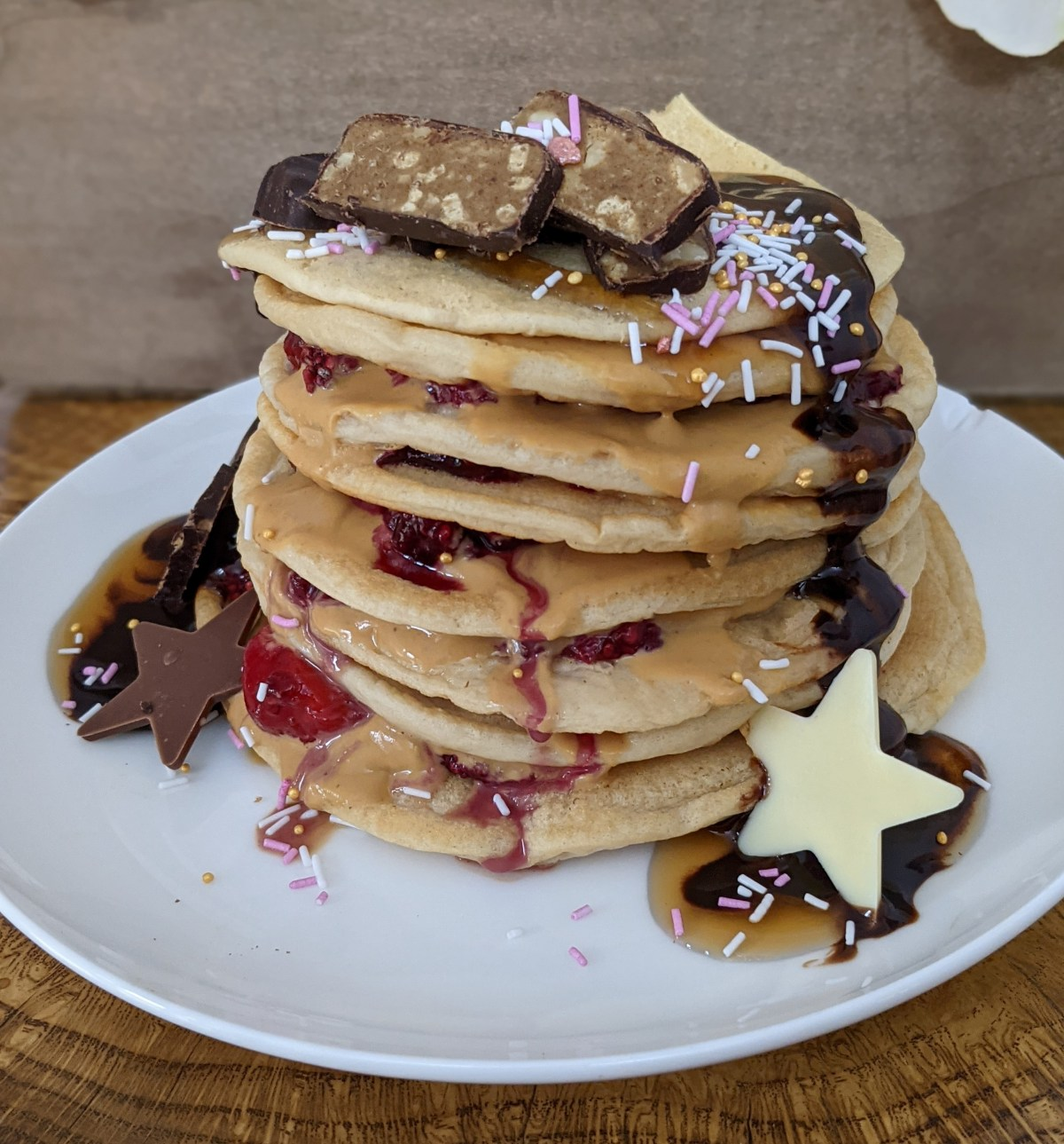 Delicious stack of pancakes that include an eat vive bar.