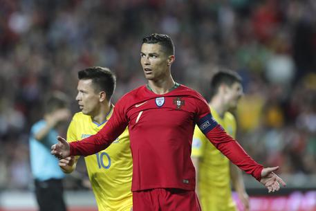epa07457150 Portugal's Cristiano Ronaldo reacts during the UEFA EURO 2020 qualification match between Portugal and Ukraine at Luz Stadium in Lisbon, Portugal, 22 March 2019.  EPA/MIGUEL A. LOPES