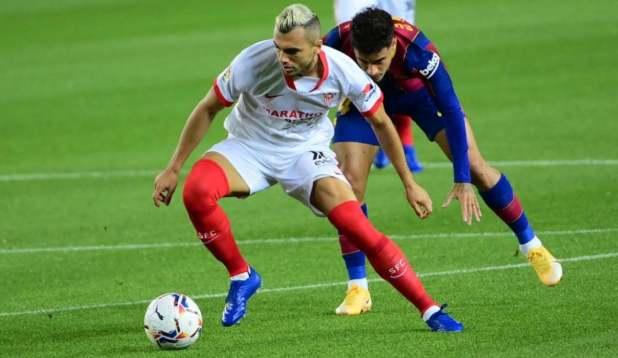 Joan Jordan of Sevilla against Barcelona
