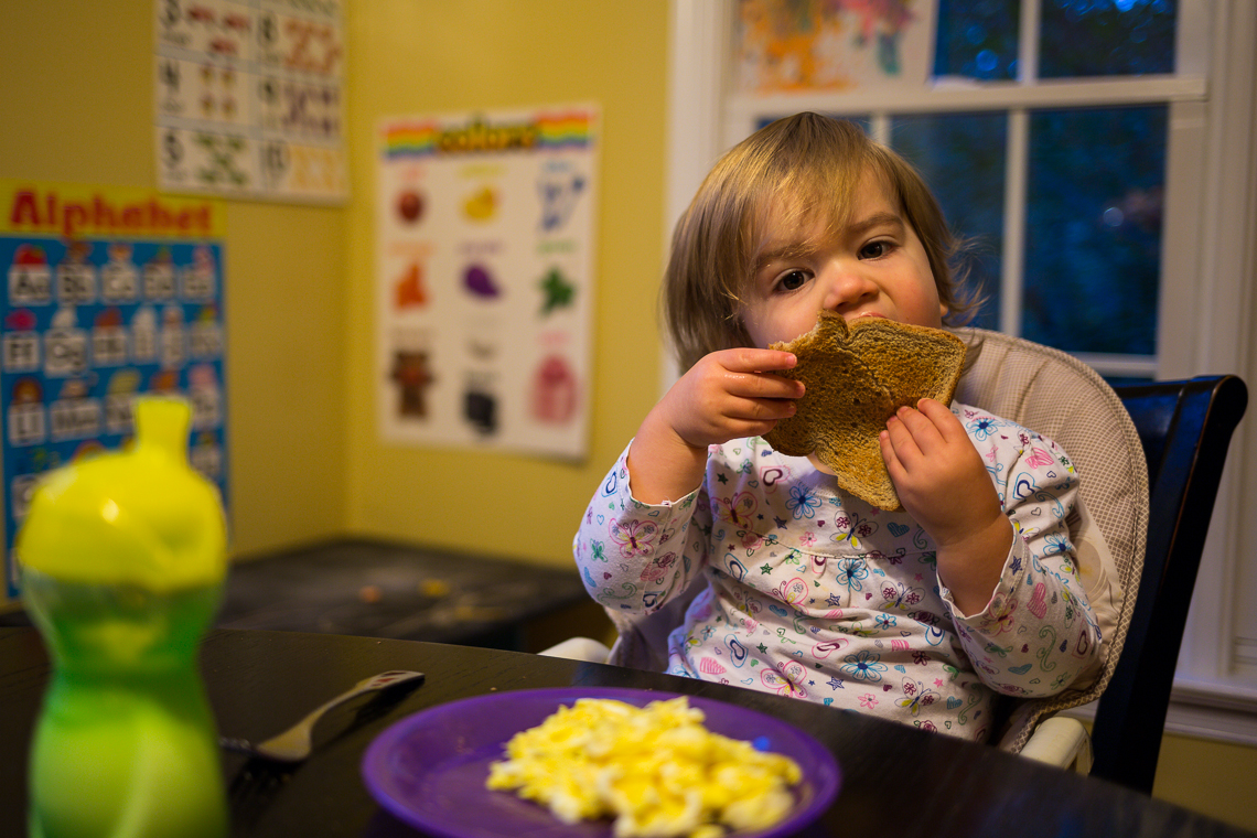 Harper eating toast for breakfast