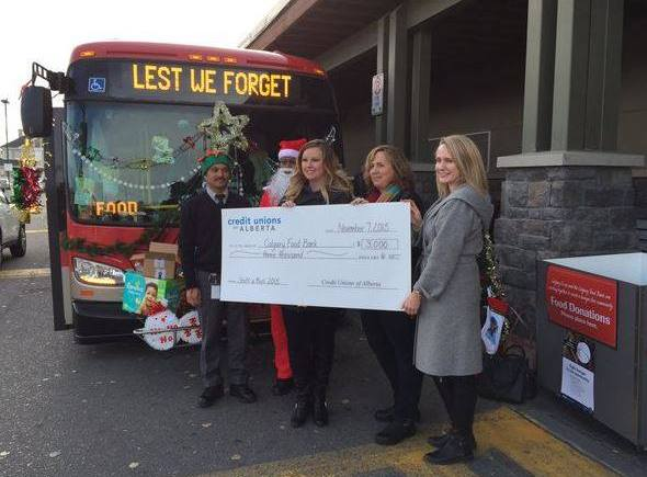 Credit Unions of Alberta donate to the Stuff-A-Bus campaign.