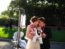 Jaime Jenett with her son Simon and wife Laura Fitch at their wedding ceremony on hospital grounds.