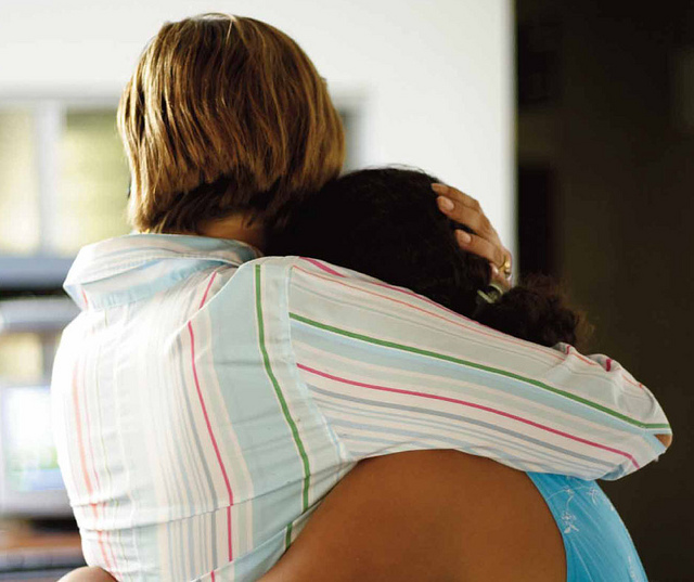 The Director of a women's shelter embraces a young survivor of sexual violence. Photo: Amnesty International/Flickr