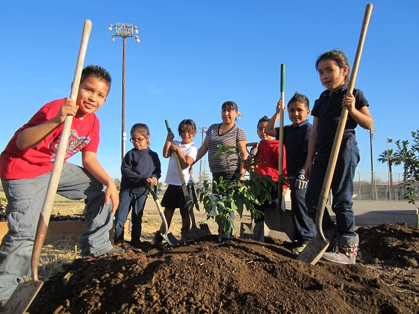 Children help plant a community garden funded by the Imperial County Childhood Obesity Project. Photo: Courtesy of the Our Choice program.