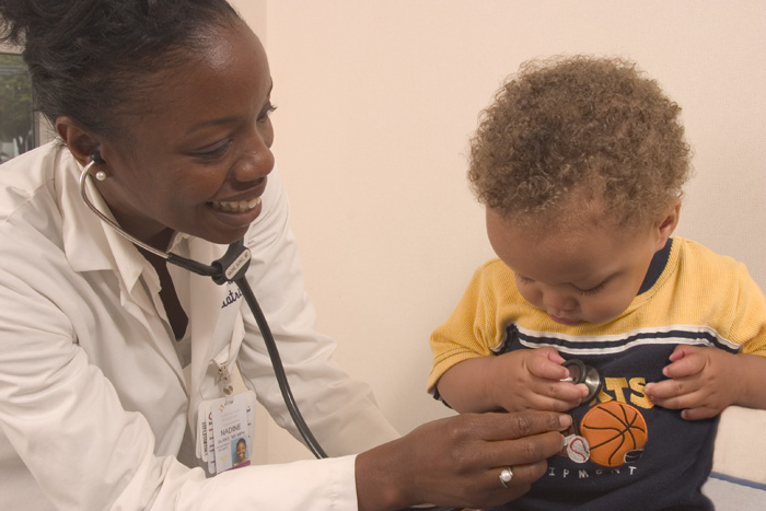 Dr. Nadine Burke Harris with a young patient at the Center for Youth Wellness.