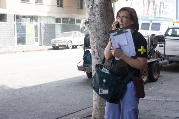 Outreach worker Julia Cross calls a physician about a full- or near-term pregnant resident of Skid Row.