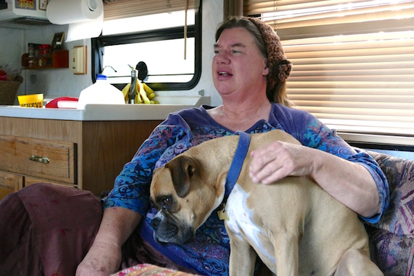 Irene Evers Elisabeth and her dog, Buster, in the RV they live in. Elisabeth is a guest in the One Starfish Safe Parking and Supportive Services program in Monterey County. Photo: Lily Dayton.
