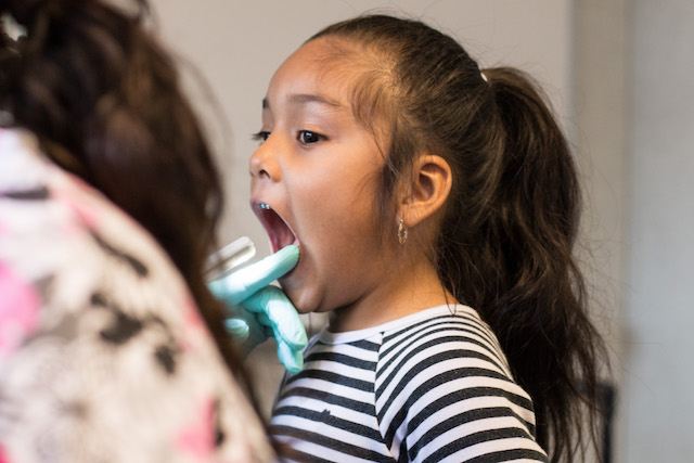 Katherine Turcios, 5, is among the first patients in a new teledentistry program designed to get care to underserved children. Photo: Jazley Faith Sendjaja.