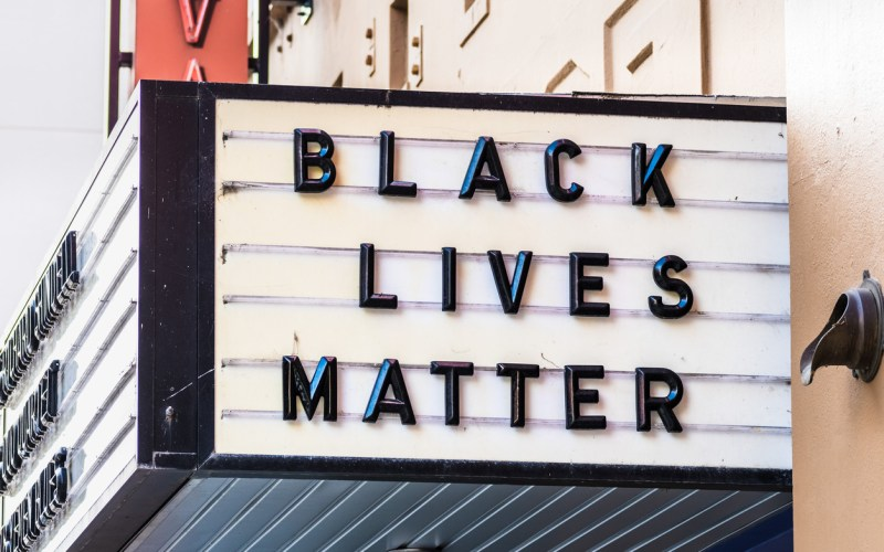 Oct 18, 2019 Berkeley / CA / USA - 'Black lives matter' slogan posted on the Freight & Salvage Coffeehouse billboard in downtown Berkeley