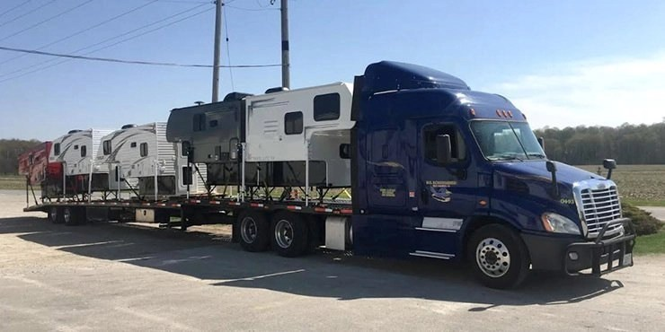 4 Rvs being transported for huge truck using open container trailer, 5th Wheel Transportation Services in California