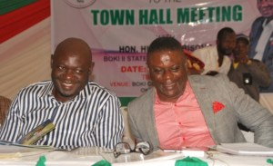Member representing Boki II State Constituency, CRSHA, Hillary Bisong (left) and CRS Commissioner for New Cities DEV., George Ekpungu, enjoy a good moment during a Town Hall meeting organised by Bisong in Okundi, Boki LGA