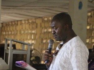 Patrick Esor Eteng, son of the deceased, readsthe biography in church.