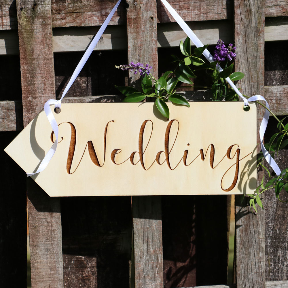directional wooden sign street