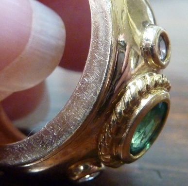 Side view of emerald ring