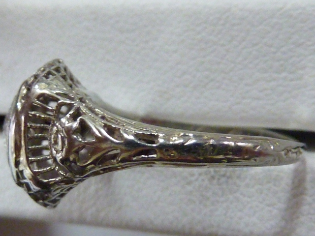 Antique ring with worn engraving on shank