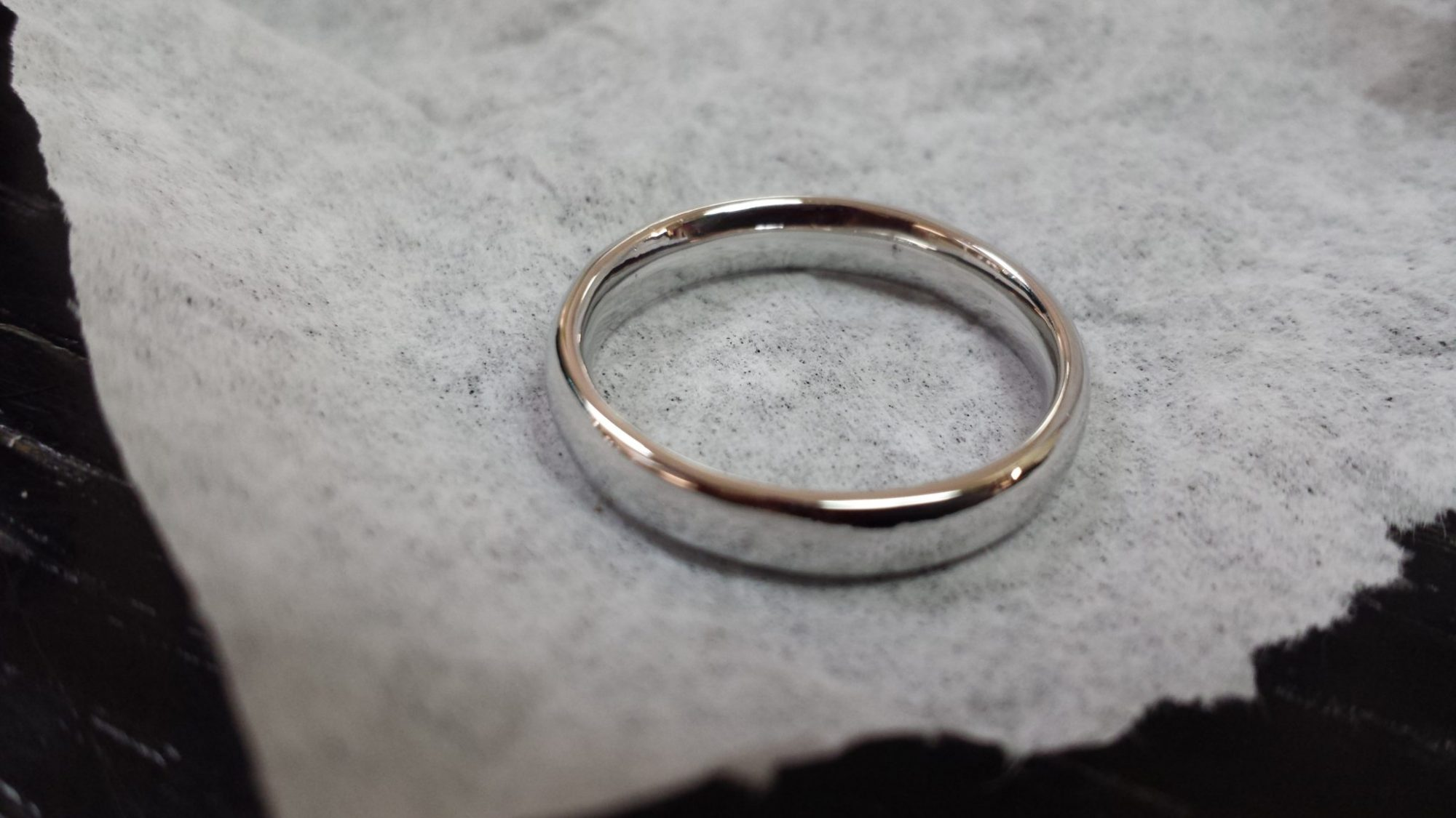 White gold wedding band after garbage disposal accident and repair