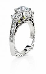 Filigree detail in three diamond engagement ring