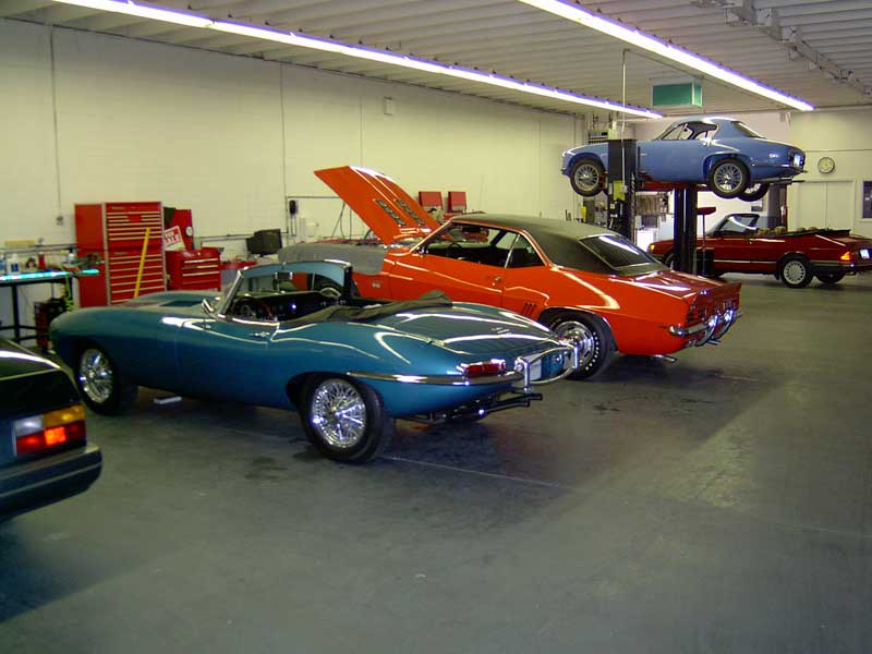 Sports Cars in a Mechanics Garage. Sports and Collector Car Center, Tempe Az.