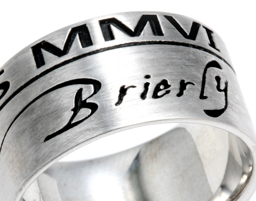 Man's ring with Lettering etched down in ring