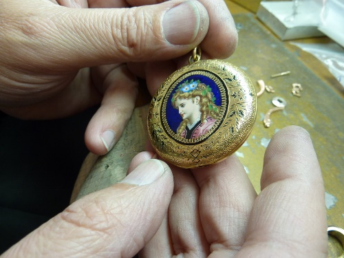 Gold and Enameled Girl Face Pendant