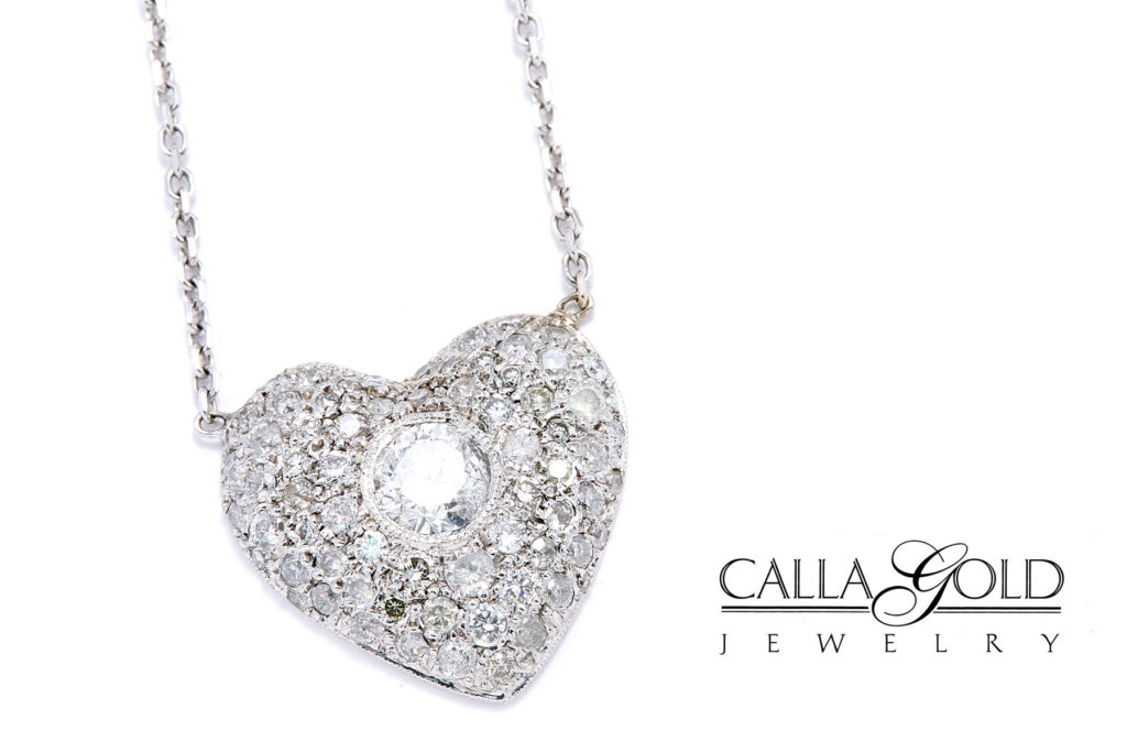 Heart shaped necklace with multiple different sized diamonds