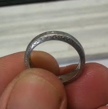 Worn down engraving on platinum wedding band.