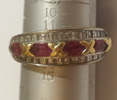 Ruby and diamond baguette white and yellow gold ring