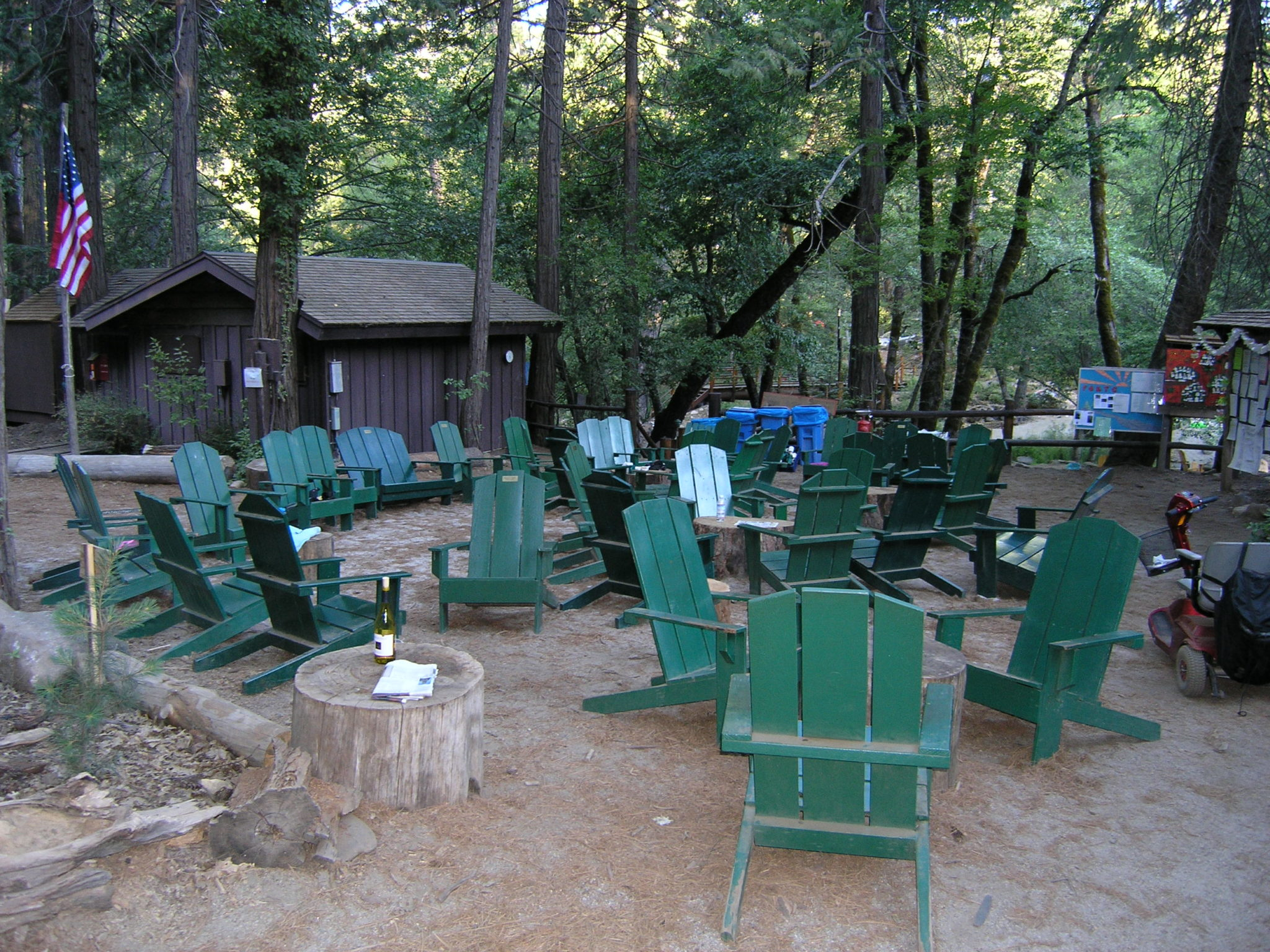 Green adirondack chairs at camp