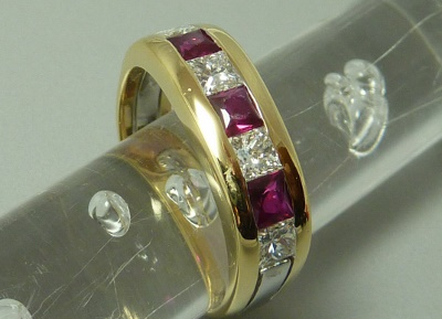 Square ruby and alternating diamonds in channel set yellow gold ring