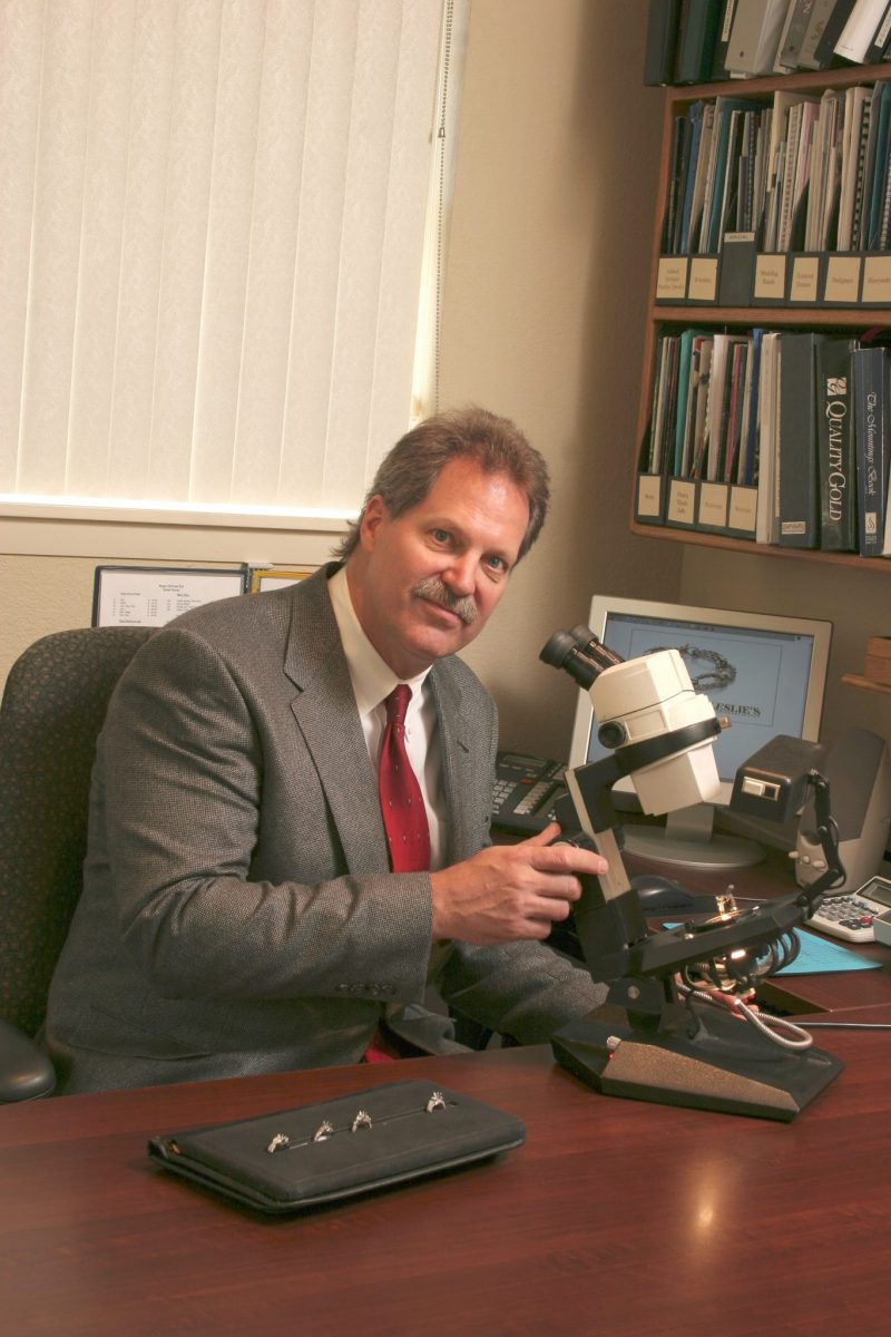 Appraiser Tom Seguin, GG, ASA, Master Appraiser at His Microscope. One of his Many Tools of the Trade.