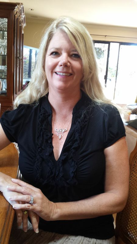 image of blonde woman wearing her new necklace