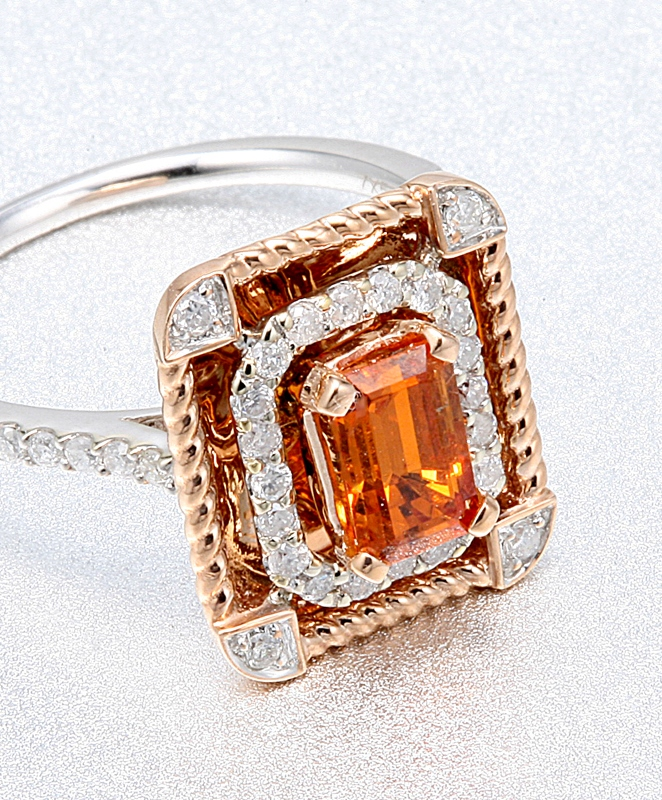 Rectangular ladies ring with orange spessartite and diamonds.