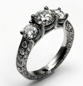 Engagement Ring with three main diamonds and black rhodium