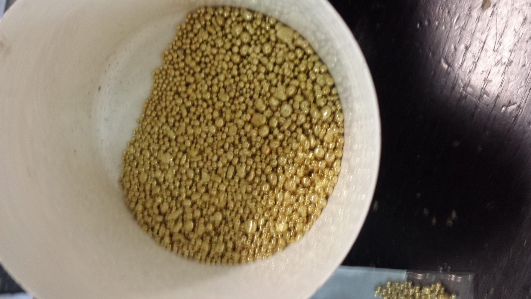 gold casting grains in bucket