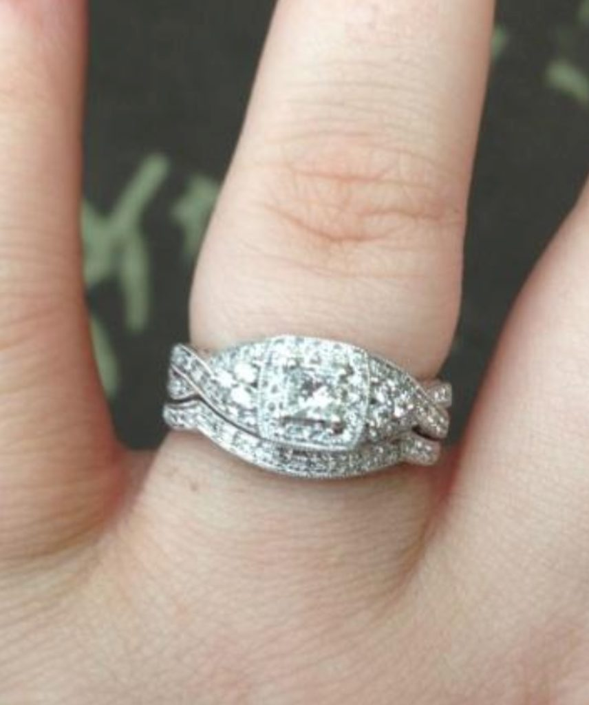 This Ring Has a .25ct Center Diamond With a Nice Bold Halo and Intertwined Band