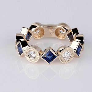 Sapphire and diamond three quarter eternity band ring