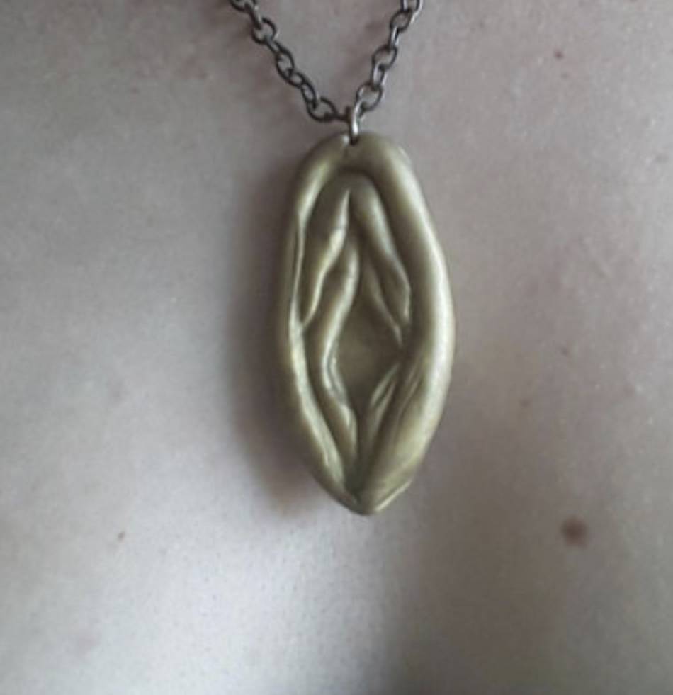 vagina necklace made of clay