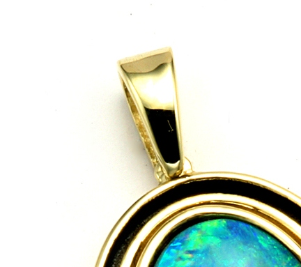 Yellow gold bail at top of pendant