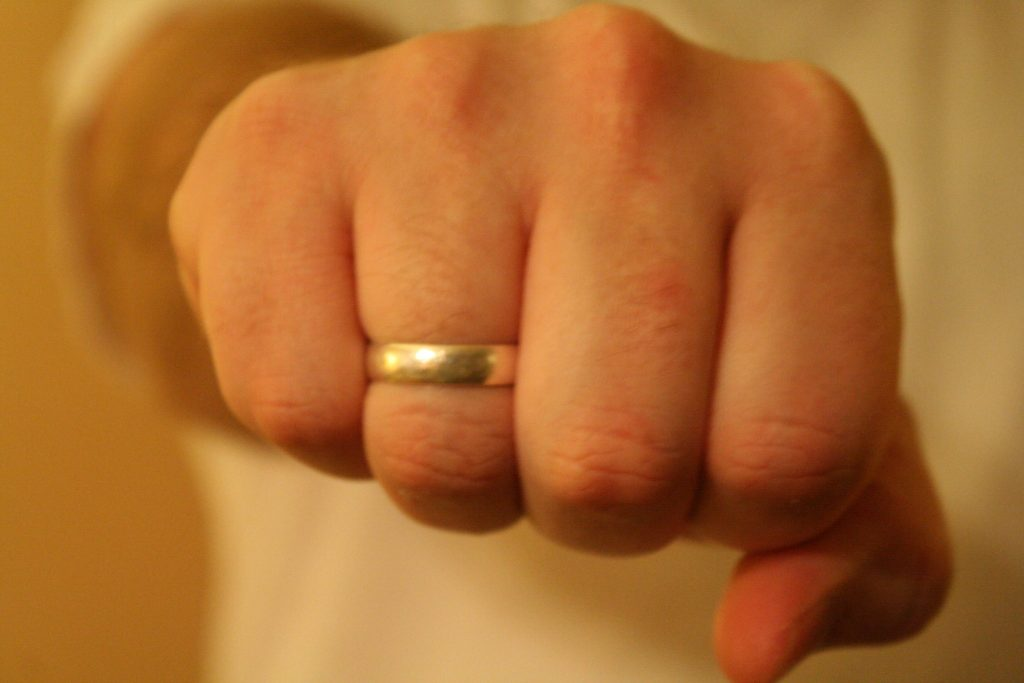 gold band on a man's hand