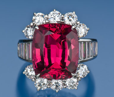 Red spinel and round diamonds semi halo and baguette diamonds on shank in channel setting