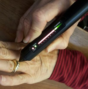 Diamond tester demonstrating with green light the gem is genuine diamond