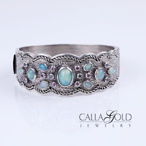 Opal bracelet in silver with purple sapphires. All bezel set with oxidation.