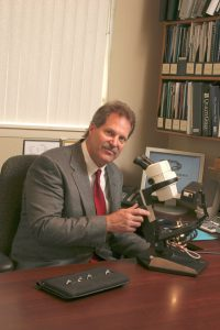 Appraiser Tom Seguin at his microscope.