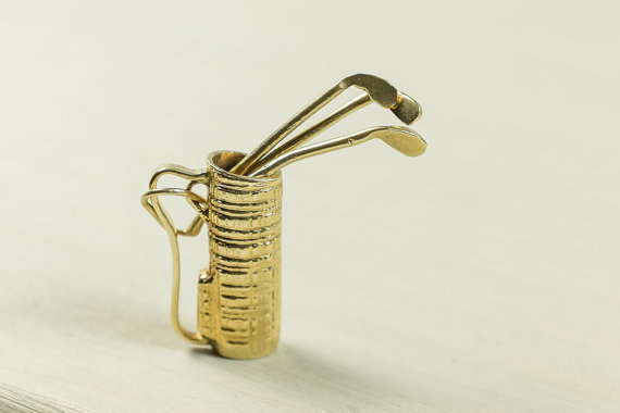 Vintage sports 14k yellow gold golf bag with movable clubs|Sterling Silver Golf Ball Cuff Links|Vintage 14k golf club charm|Tea Off Golf Ball Pendant 14k white gold|14kt golf ball engagement ring for men by CADI Jewlery|18k gold diamond golf ring|HERMES Gorgeous RARE vintage silver tone Golf paper clip holder|18k gold diamond blue sapphire golf bag pin|Diamond Golf Tee Necklace|Golfing at sunset