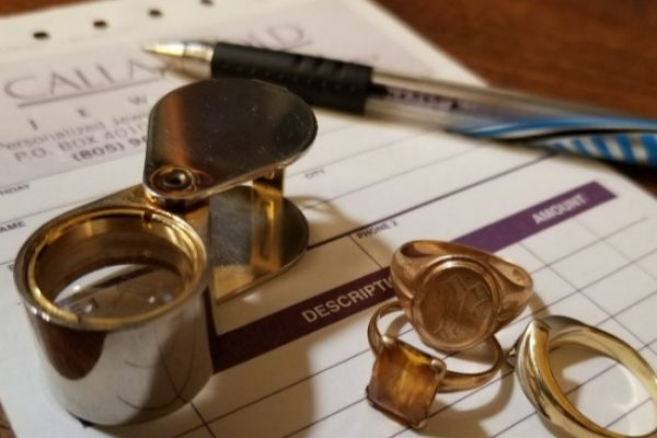 Loupe and rings and pen