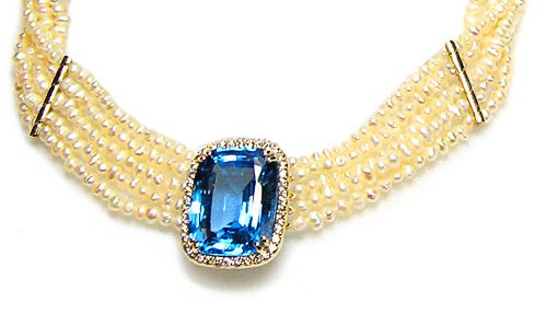 Blue topaz and diamond halo pendant on five strand fresh water pearl choker necklace